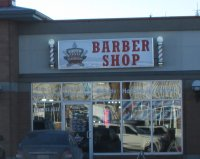 Store front for South Trail Barber Shop